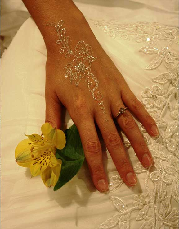 Free handed wedding glitter tattoo made with diamond glitter